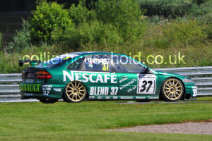 Race 1 saw the podium completed by Simon Garrad's Renault Laguna
